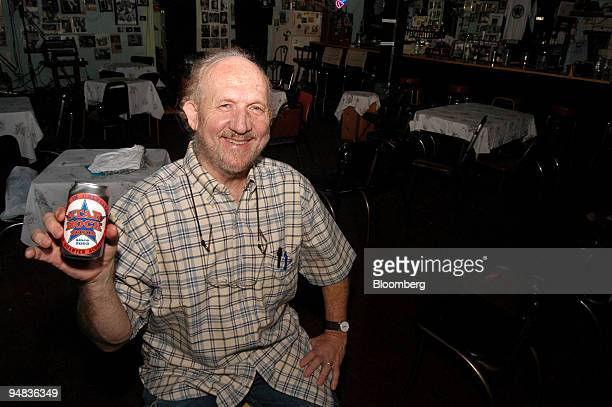 Bar owner Rex 'Wrecks' Bell holds a can of his Star Bock beer at his Old Quarter Accoustic Cafe in Galveston Texas on Tuesday April 27 2004 Bell has...