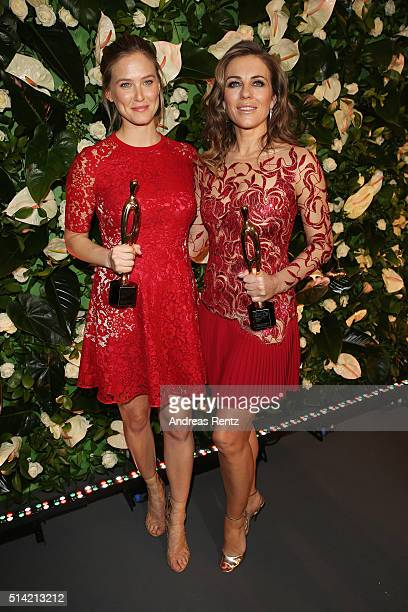 Bar Refaeli and Elizabeth Hurley pose with their awards during the PEOPLE Style Awards at Hotel Vier Jahreszeiten on March 7 2016 in Munich Germany