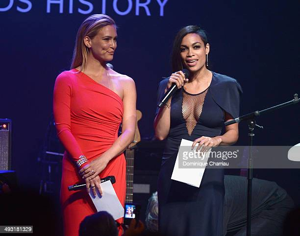 Bar Refaeli and Rosario Dawson speak onstage during amfAR's 21st Cinema Against AIDS Gala Presented By WORLDVIEW BOLD FILMS And BVLGARI at Hotel du...