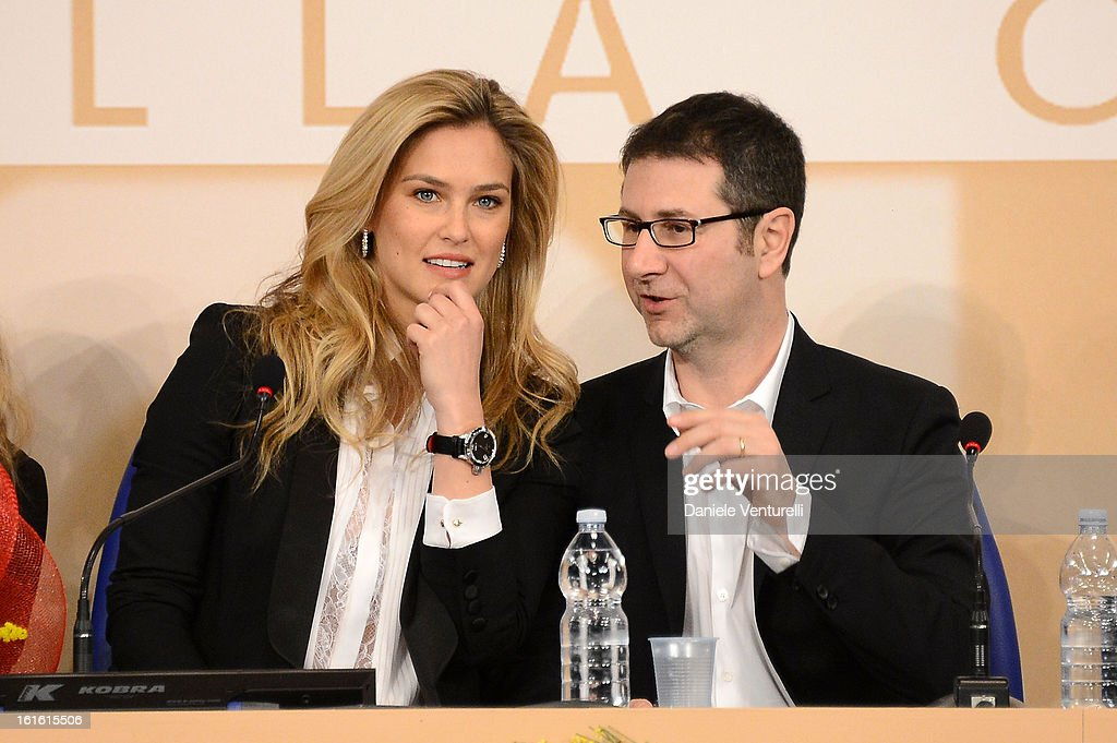 <a gi-track='captionPersonalityLinkClicked' href=/galleries/search?phrase=Bar+Refaeli&family=editorial&specificpeople=468932 ng-click='$event.stopPropagation()'>Bar Refaeli</a> and tv presenter <a gi-track='captionPersonalityLinkClicked' href=/galleries/search?phrase=Fabio+Fazio&family=editorial&specificpeople=774725 ng-click='$event.stopPropagation()'>Fabio Fazio</a> attend the Day 2 Photocall during the 63th Festival di Sanremo 2013 on February 13, 2013 in Sanremo, Italy.