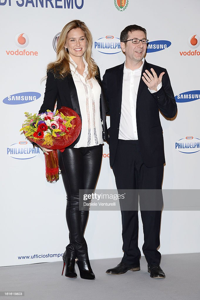 Bar Refaeli and tv presenter Fabio Fazio attend the Day 2 Photocall during the 63th Festival di Sanremo 2013 on February 13, 2013 in Sanremo, Italy.