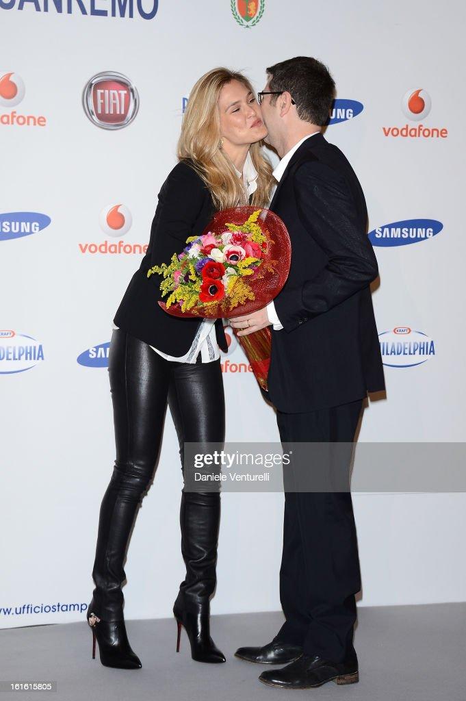 Bar Refaeli and tv presenter Fabio Fazio attend the Day 2 Photocall during the 63th Festival di Sanremo 2013 on February 13, 2013 in Sanremo, Italy.