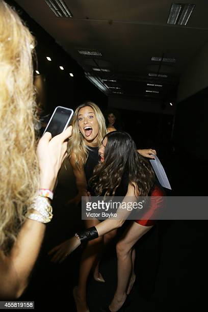 Bar Refaeli and Valentina Micchetti attend the amfAR Milano 2014 Gala Dinner and Auction as part of Milan Fashion Week Womenswear Spring/Summer 2015...