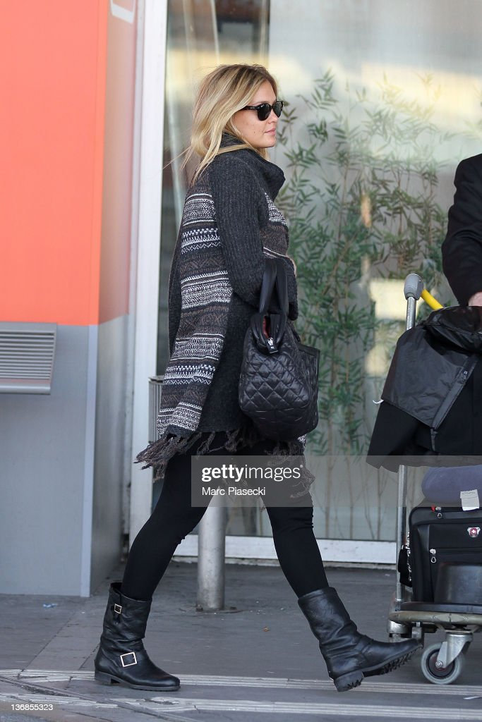 Bar Refaeli arrives at Airport Roissy Charles de Gaulle on January 12, 2012 in Paris, France.
