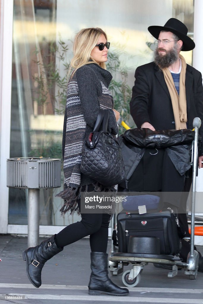 <a gi-track='captionPersonalityLinkClicked' href=/galleries/search?phrase=Bar+Refaeli&family=editorial&specificpeople=468932 ng-click='$event.stopPropagation()'>Bar Refaeli</a> arrives at Airport Roissy Charles de Gaulle on January 12, 2012 in Paris, France.