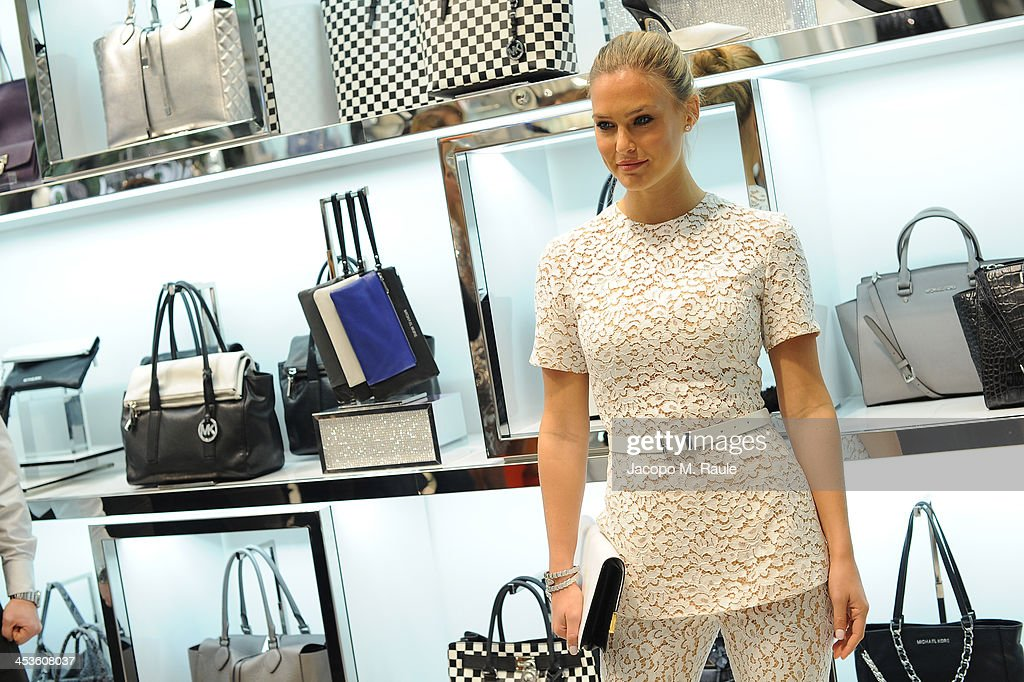 <a gi-track='captionPersonalityLinkClicked' href=/galleries/search?phrase=Bar+Refaeli&family=editorial&specificpeople=468932 ng-click='$event.stopPropagation()'>Bar Refaeli</a> attends the Michael Kors To Celebrate Milano opening on December 4, 2013 in Milan, Italy.