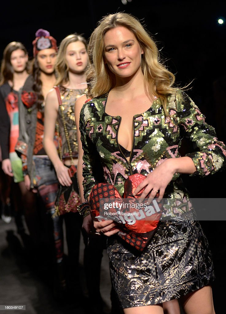 Bar Refaeli presents a creation by Desigual during the 080 Barcelona 'Autumn-Winter 2013-2014' fashion week in Barcelona on January 29, 2013 in Barcelona, Spain.