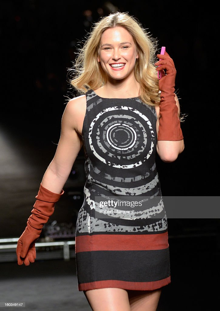 <a gi-track='captionPersonalityLinkClicked' href=/galleries/search?phrase=Bar+Refaeli&family=editorial&specificpeople=468932 ng-click='$event.stopPropagation()'>Bar Refaeli</a> presents a creation by Desigual during the 080 Barcelona 'Autumn-Winter 2013-2014' fashion week in Barcelona on January 29, 2013 in Barcelona, Spain.