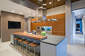 Bar stools at breakfast bar in contemporary kitchen