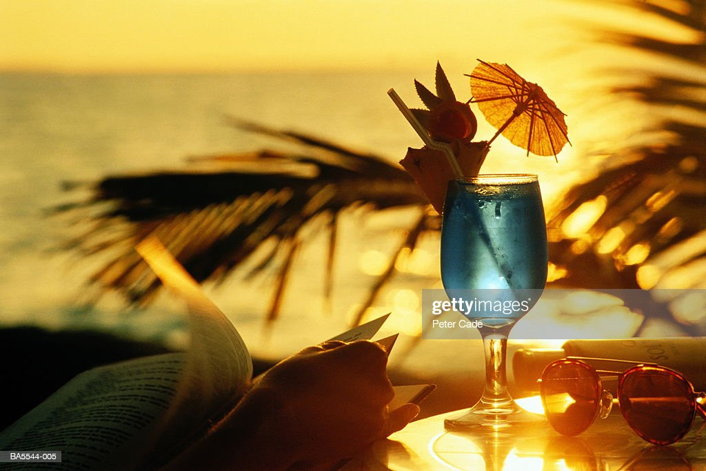 Bar table overlooking tropical beach at sunset, close-up : Stock Photo