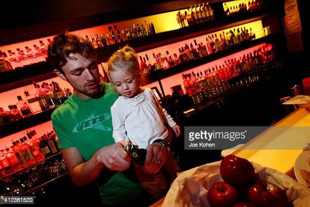 Bar tender and little girl behind the bar at the Cileo club in New York City during the 'Baby Loves Disco' Party on Jan 13 2007 The monthly event is...