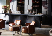 A bar tender prepares a cocktail in the 'Nuts Co' bar at the InterContinental hotel Davos operated by InterContinental Hotels Group Plc in this...