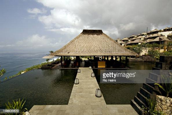 Bar walkway reflecting pool and villas in background at the Bulgari resort in Pecatu on the Bukit peninsula of southern Bali