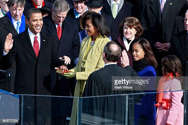 Barack H Obama is sworn in by Chief Justice John Roberts as the 44th president of the United Statesas on the West Front of the Capitol as his wife...