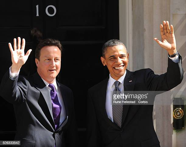 Barack Obama and David Cameron attend a meeting at No 10 Downing Street during President Obama's State Visit