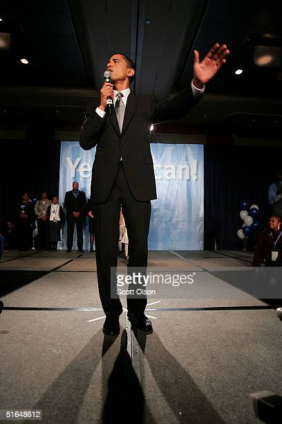 Barack Obama greets supporters following his victory over Republican rival Alan Keyes November 2 2004 in Chicago Illinois