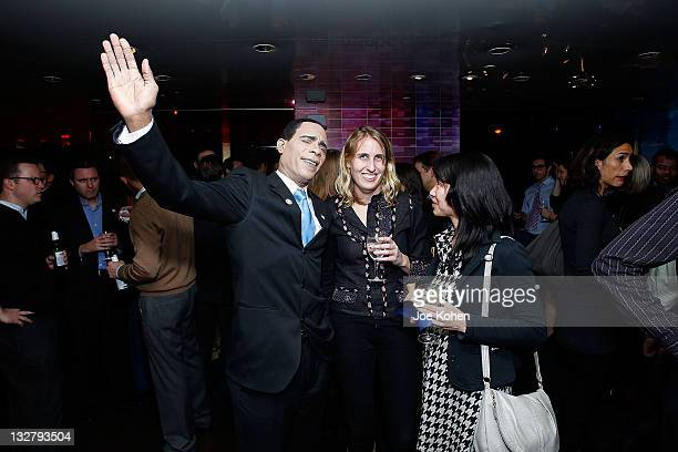 Barack Obama impersonator poses with guests at the BLTWYcom Launch Party Hosted By BermanBraun and MSNBC at Digital Cafe At Rockefeller Center on...