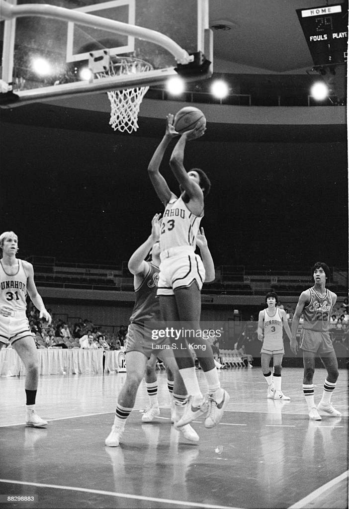 Barack Obama shoots the ball while playing as a guard for the state champion Punahou School basketball team Hawaii 1979