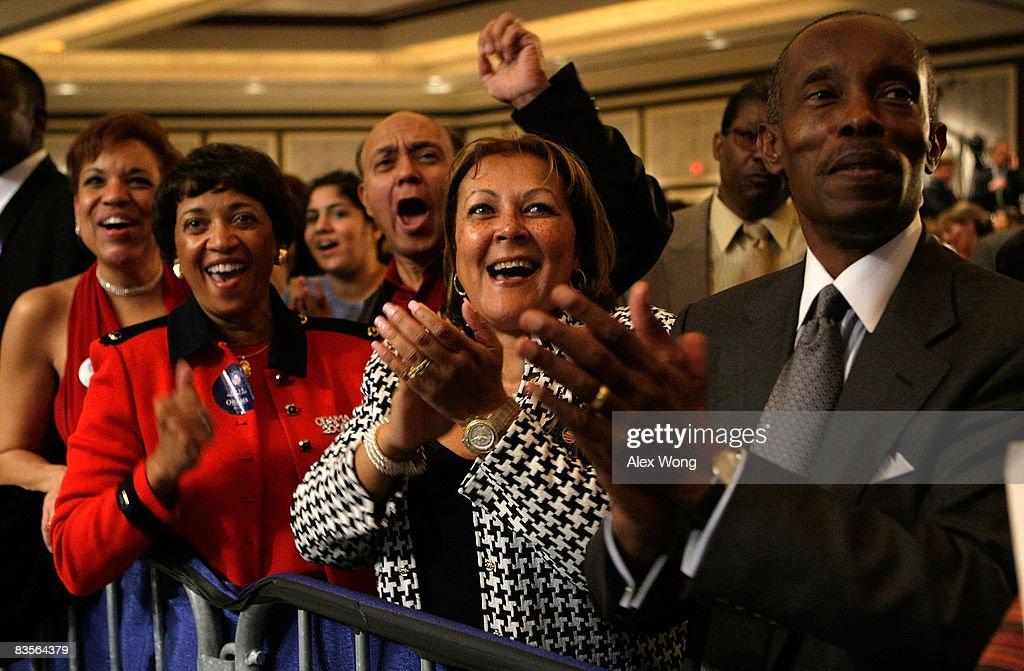 Barack Obama supporters George Lambert Bernardette CurtisLambert Roy Heron Sandra Stiner Lowe and Barbara Heron celebrate as they watch the poll...
