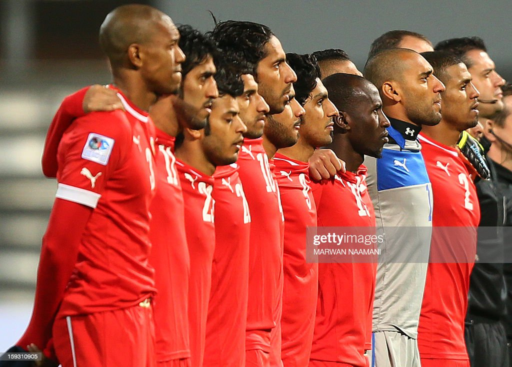 Barain's national football team's players listen to their country's national anthem prior to the Gulf Cup football match Bahrain versus Qatar on January 11, 2013 in the Bahraini capital of Manama.