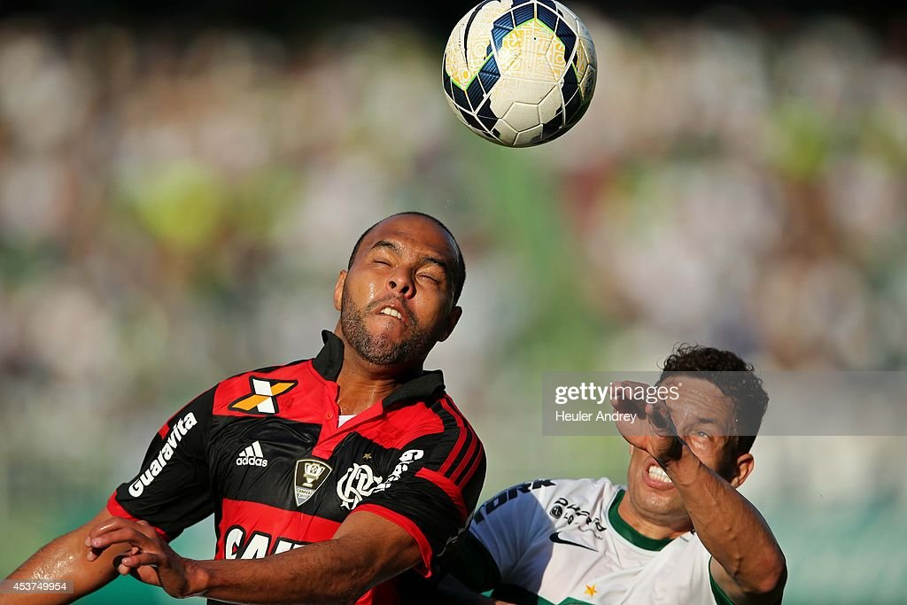Baraka of Coritiba competes for the ball with Alecsandro of Flamengo during the match between Coritiba and Flamengo for the Brazilian Series A 2014 at Couto Pereira stadium on August 17, 2014 in Curitiba, Brazil.