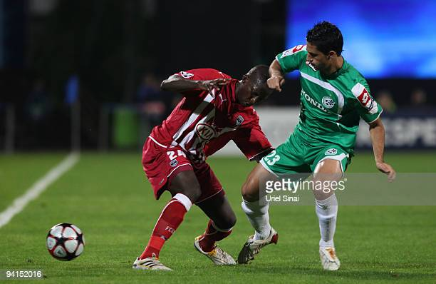 Baram Kayal of Maccabi Haifa and Abdou Traore of Bordeaux play the ball during their UEFA Champions League Group A matchday 6 game on December 8 2009...