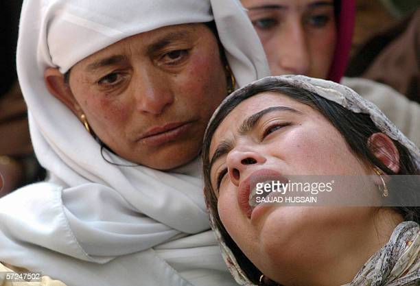 Kashmiri Muslim women grieve at a funeral service for Congress Party Municipal Councillor Wali Mohammed Dar in Baramulla some 55kms north of Srinagar...