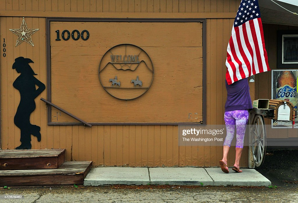 Barb Hagen coowner of the Cattleman's Casino and Bar put up a flag she bought for the presidential visit She's a big fan of the president and she...