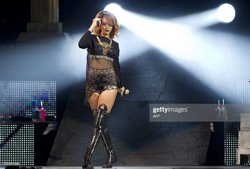 Barbadian singer Rihanna performs on stage during a concert at the Ziggo Dome in Amsterdam on June 23, 2013. AFP PHOTO / ANP KIPPA / PAUL BERGEN netherlands out