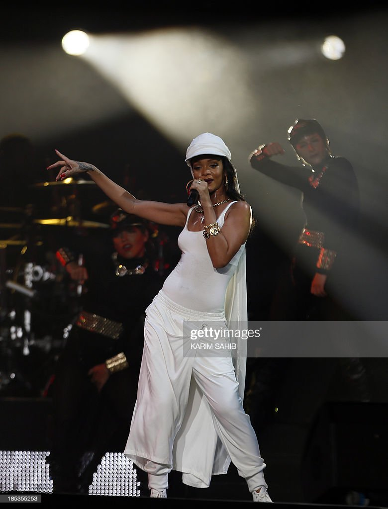 Barbadian singer Rihanna performs on stage during a concert on October 19, 2013 in Abu Dhabi. AFP PHOTO / KARIM SAHIB