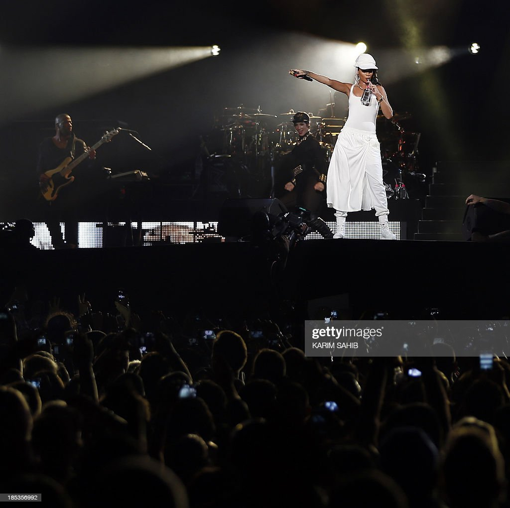 Barbadian singer Rihanna performs on stage during a concert on October 19, 2013 in Abu Dhabi.