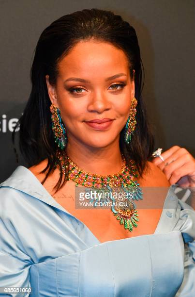 Barbadian singer Rihanna poses as she arrives for the Chopard 'Space' party on the sidelines of the 70th Cannes film festival on May 19 2017 in...