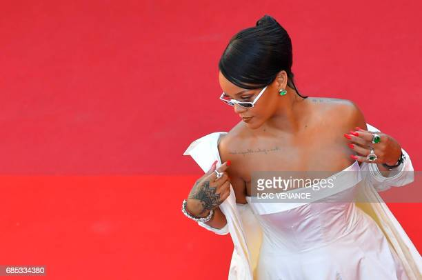 Barbadian singer Rihanna poses as she arrives on May 19 2017 for the screening of the film 'Okja' at the 70th edition of the Cannes Film Festival in...