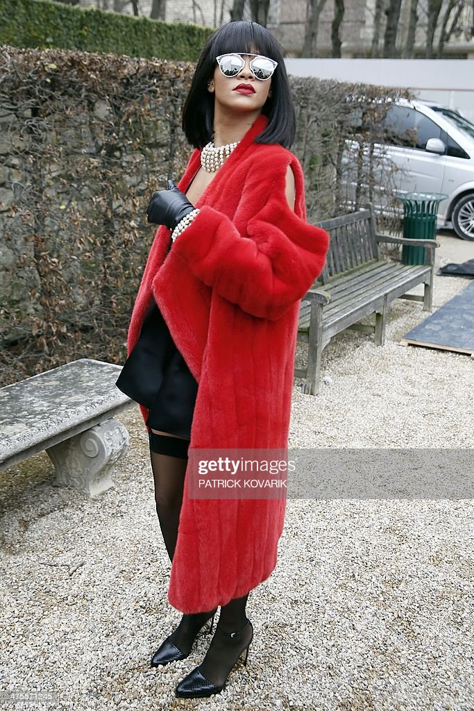 Barbadian singer Rihanna poses as she arrives to attend Christian Dior 2014/2015 Autumn/Winter readytowear collection fashion show on February 28...