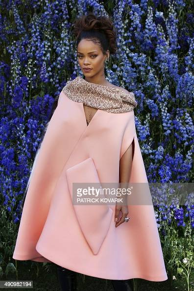 Barbadian singer Rihanna poses prior to the start of the Christian Dior 2016 Spring/Summer readytowear collection fashion show on October 2 2015 in...