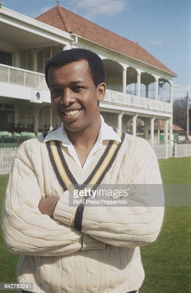 Barbados born cricketer and player for Hampshire County Cricket Club John Holder posed in front of the main stand and club house at the County Ground...