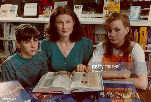 Barbara Anderson with daughters Laura 11 and Cara 14 points to an error in a textbook Credit Denver Post