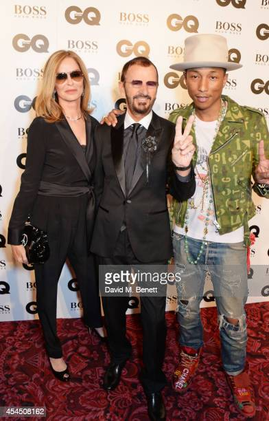Barbara Bach Ringo Starr and Pharrell Williams attend the GQ Men Of The Year awards in association with Hugo Boss at The Royal Opera House on...