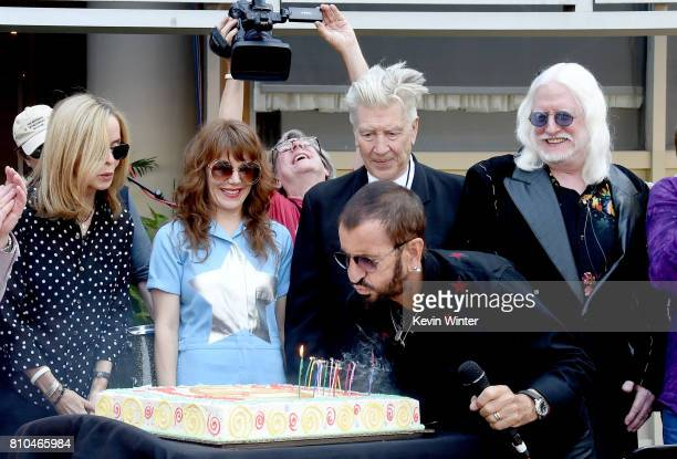 R Barbara Bach singer Jenny Lewis director David Lynch musician Ringo Starr and musician Edgar Winter appear at the 'Peace Love' birthday celebration...