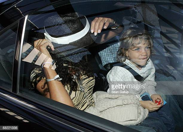 Barbara Becker former wife of tennis great Boris Becker leaves the Intercontinental Hotel with their son Elias July 10 2005 in Berlin Germany