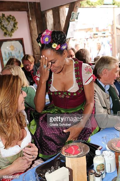 Barbara Becker wearing a dirndl by Sportalm during the Oktoberfest 2015 Opening at Kaeferschaenke beer tent at Theresienwiese on September 19 2015 in...