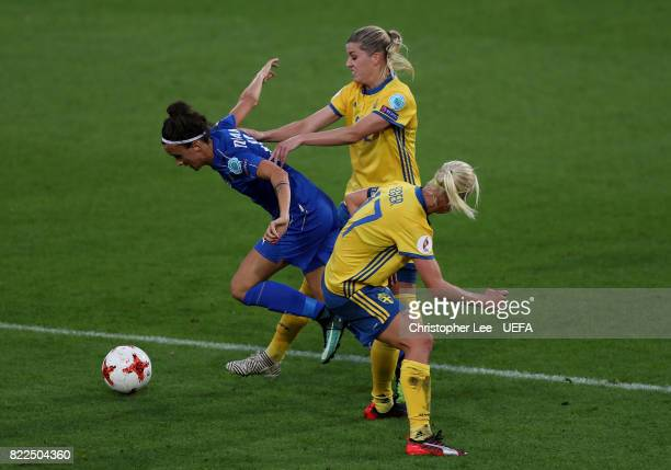 Barbara Bonansea of Italy gets past Olivia Schough and Caroline Seger of Sween during the UEFA Women's Euro 2017 Group B match between Sweden and...