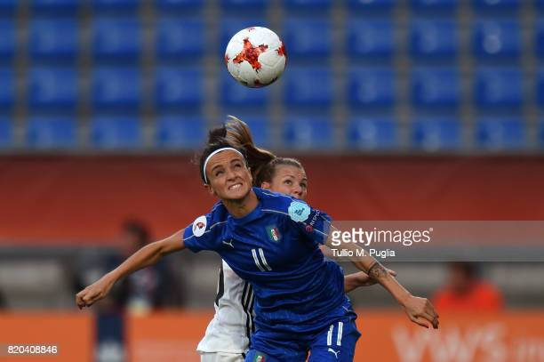 Barbara Bonansea of Italy is challenged by Linda Dallmann of Germany during the UEFA Women's Euro 2017 Group B match between Germany and Italy at...