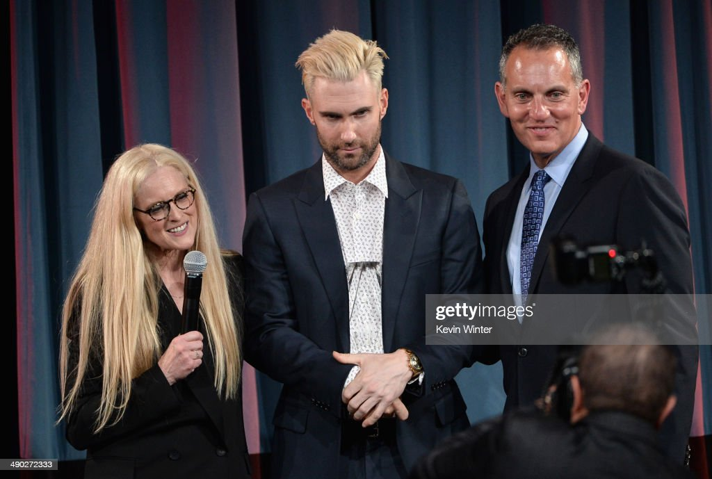 Barbara Cane, BMI VP & General Manager, Writer/Publisher Relations and Michael O'Neill, BMI CEO present the 2014 BMI Songwriter of the Year Award to singer-songwriter Adam Levine (center) of Maroon 5 onstage at the 62nd annual BMI Pop Awards at the Regent Beverly Wilshire Hotel on May 13, 2014 in Beverly Hills, California.