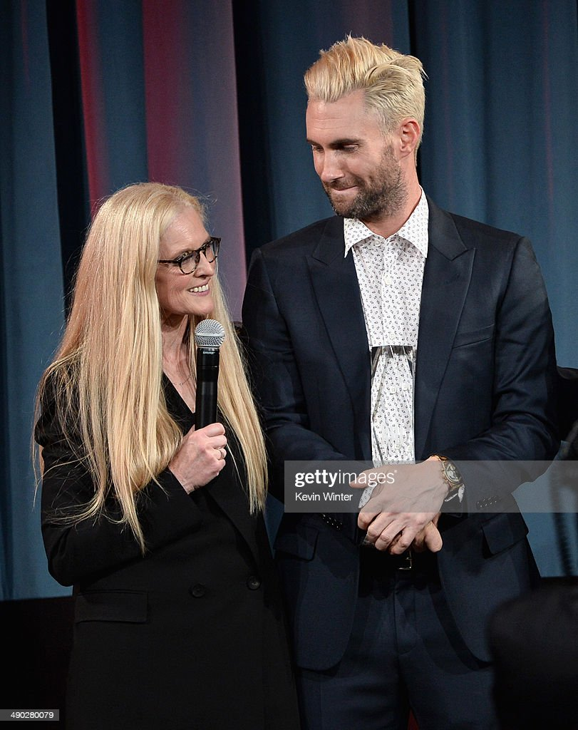 Barbara Cane, BMI VP & General Manager, Writer/Publisher Relations (L) presents the 2014 BMI Songwriter of the Year Award to singer-songwriter Adam Levine of Maroon 5 onstage at the 62nd annual BMI Pop Awards at the Regent Beverly Wilshire Hotel on May 13, 2014 in Beverly Hills, California.