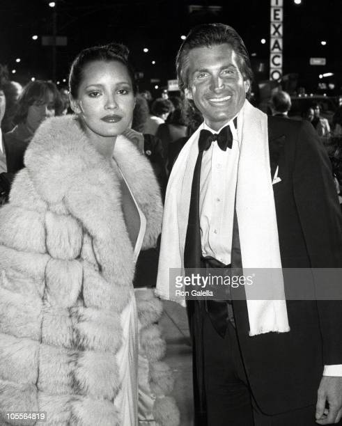 Barbara Carrera and George Hamilton during 'Sextette' New York Premiere at Dome Theater in New York City New York United States