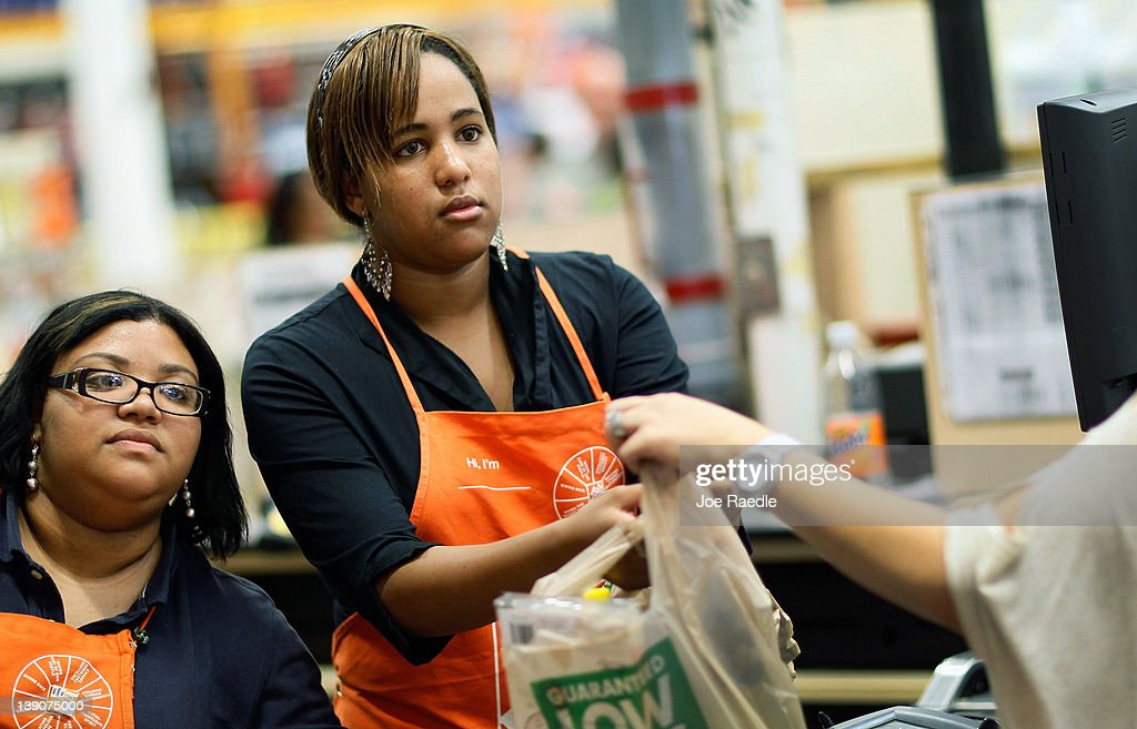 Barbara Chico (L) who was recently hired by The Home Depot , listens as Home Depot Associate, Mirisol Del Risco while they ring up a customer on February 16, 2012 in Miami, Florida. The Home Depot company announced that it will be hiring 70,000 new seasonal workers as U.S. unemployment claims have fallen to their lowest level in four years.