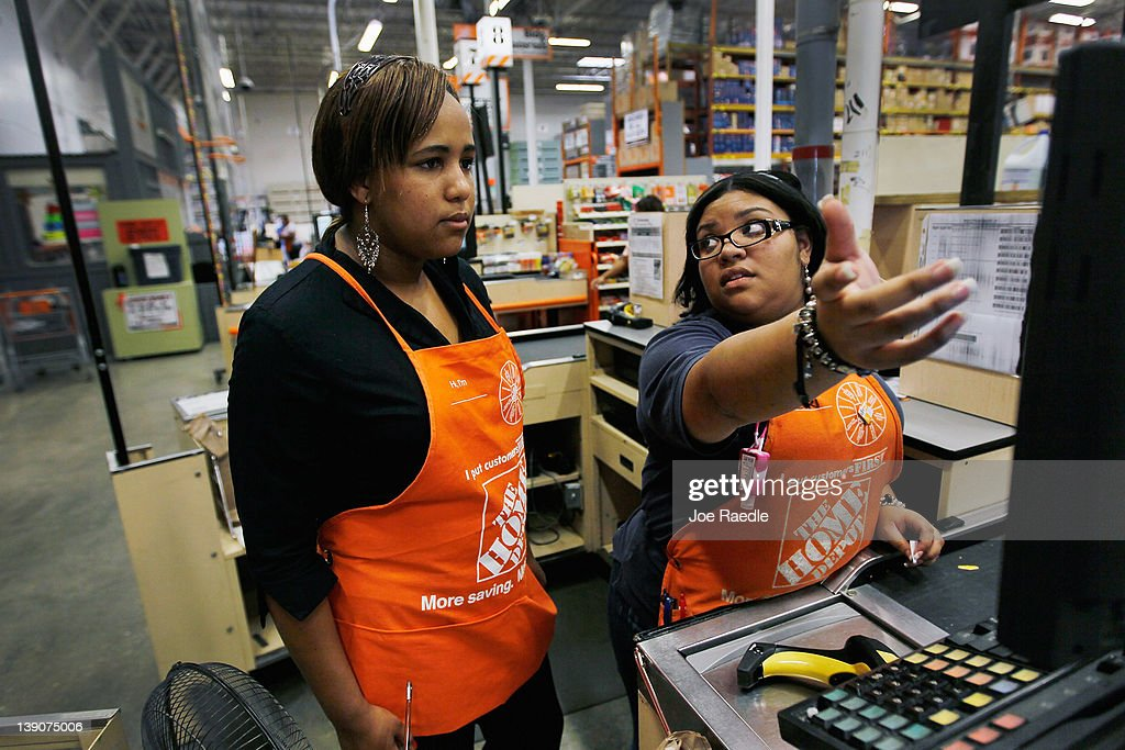 Barbara Chico (L) who was recently hired by The Home Depot , listens as Home Depot Associate, Mirisol Del Risco trains her on using the cash register on February 16, 2012 in Miami, Florida. The Home Depot company announced that it will be hiring 70,000 new seasonal workers as U.S. unemployment claims have fallen to their lowest level in four years.