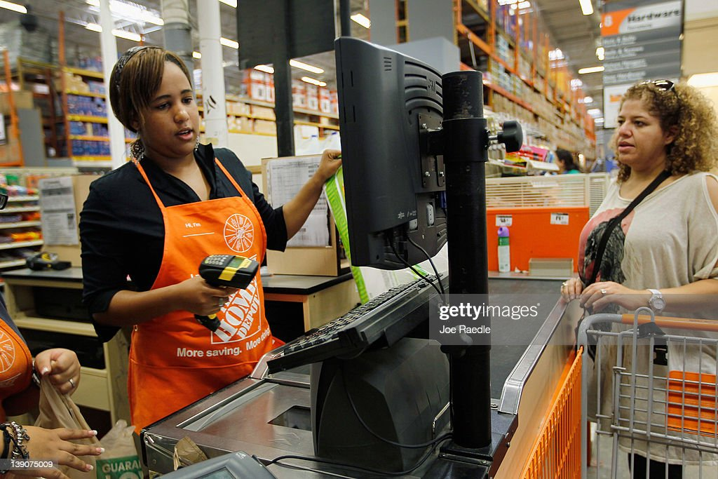 Barbara Chico (L) who was recently hired by The Home Depot rings up a sale for Rosanna Benhaddouch while being trained on the cash register on February 16, 2012 in Miami, Florida. The Home Depot company announced that it will be hiring 70,000 new seasonal workers as U.S. unemployment claims have fallen to their lowest level in four years.