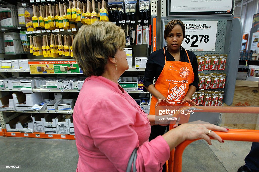 Barbara Chico (R), who was recently hired by The Home Depot, talks with customer Lourdes Hernandez while continuing her training to be a Home Depot Associate on February 16, 2012 in Miami, Florida. The Home Depot company announced that it will be hiring 70,000 new seasonal workers as U.S. unemployment claims have fallen to their lowest level in four years.